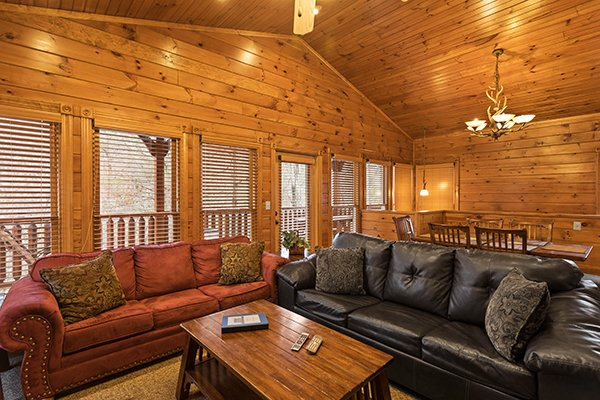 Living room with two sleeper sofas at Heaven's Dew, a 1-bedroom cabin rental located in Gatlinburg