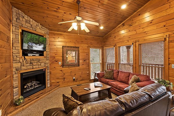 Living room with fireplace, TV, and vaulted ceiling Heaven's Dew, a 1-bedroom cabin rental located in Gatlinburg