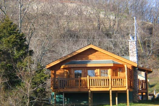 a log cabin with stone stacked chimney called gone fishin' a 2 bedroom cabin rental located in pigeon forge