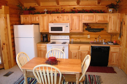 kitchen with table for four at gone fishin' a 2 bedroom cabin rental located in pigeon forge