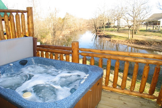 Hot tub on deck at Gone Fishin', a 2-bedroom cabin rental located in Pigeon Forge