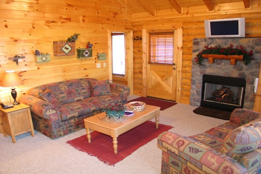 stone fireplace in living room at gone fishin' a 2 bedroom cabin rental located in pigeon forge