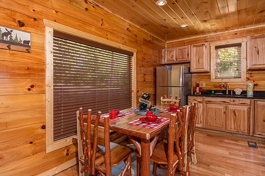 Dining table with seating for six at Canyon Camp Falls, a 2-bedroom cabin rental located in Pigeon Forge