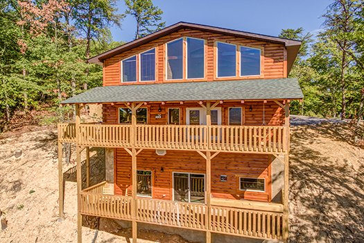 Looking back at the cabin with two levels of deck at Canyon Camp Falls, a 2-bedroom cabin rental located in Pigeon Forge