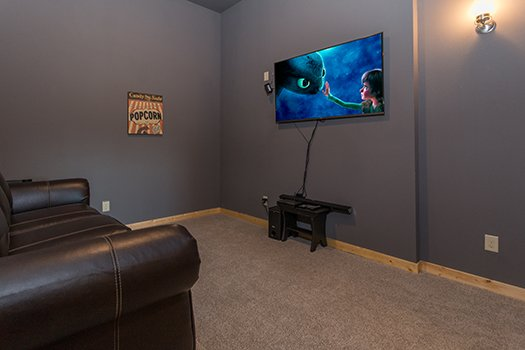 Home theater room at Canyon Camp Falls, a 2-bedroom cabin rental in Pigeon Forge