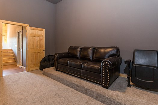 Seating in the home theater at Canyon Camp Falls, a 2-bedroom cabin rental in Pigeon Forge
