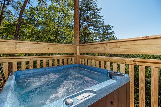 Hot tub on the deck at Canyon Camp Falls, a 2-bedroom cabin rental in Pigeon Forge