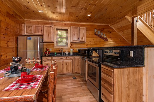 Kitchen with stainless steel appliances at Canyon Camp Falls, a 2-bedroom cabin rental located in Pigeon Forge