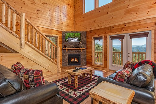 Living room with a fireplace and TV at Canyon Camp Falls, a 2-bedroom cabin rental located in Pigeon Forge