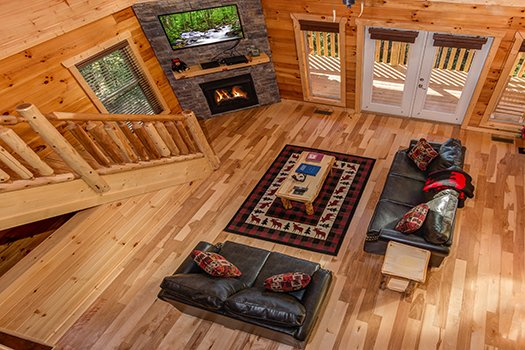 Looking down into the living room from the second floor at Canyon Camp Falls, a 2-bedroom cabin rental located in Pigeon Forge