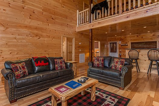 Couch and loveseat in the living room at Canyon Camp Falls, a 2-bedroom cabin rental located in Pigeon Forge