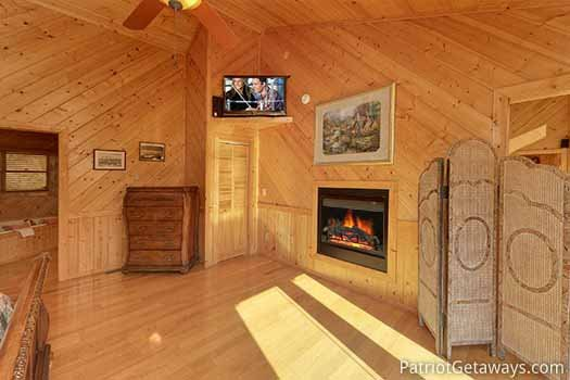 Bedroom with fireplace and closet attached at About Time, a 2 bedroom cabin rental located in Pigeon Forge