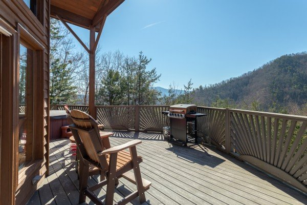 Rocking chairs and grill on a deck with mountain views at About Time, a 2 bedroom cabin rental located in Pigeon Forge