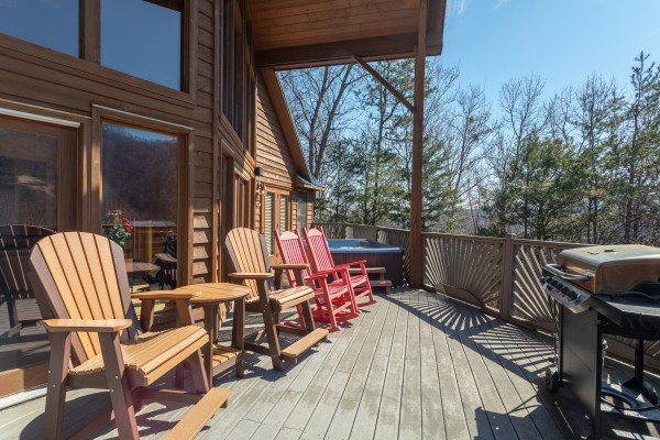 Rocking chairs on the deck at About Time, a 2 bedroom cabin rental located in Pigeon Forge