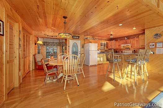 Kitchen and dining area at About Time, a 2 bedroom cabin rental located in Pigeon Forge
