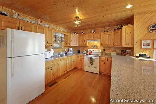 Enough room to cook that family recipe at About Time, a 2 bedroom cabin rental located in Pigeon Forge