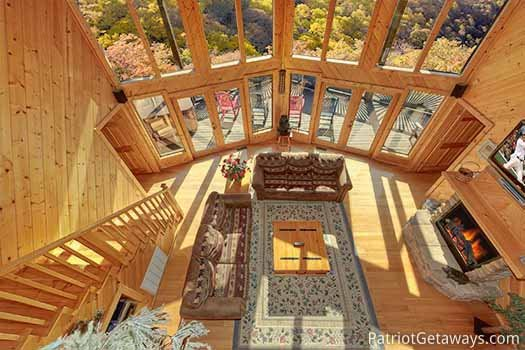 Looking down into the living room from the lofted game room at About Time, a 2 bedroom cabin rental located in Pigeon Forge