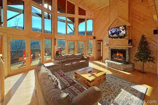 Large living room with stone fireplace at About Time, a 2 bedroom cabin rental located in Pigeon Forge