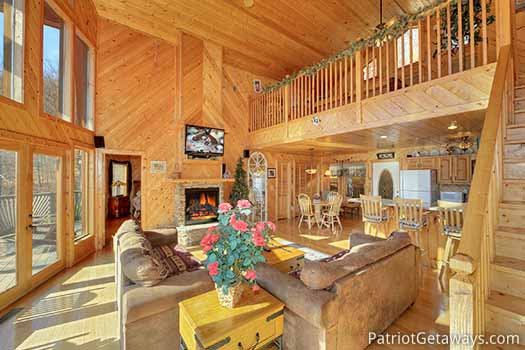 Plenty of natural light fills the living room at About Time, a 2 bedroom cabin rental located in Pigeon Forge