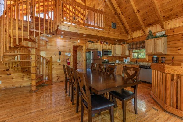 Dining space for eight at The Great Outdoors, a 3 bedroom cabin rental located in Pigeon Forge