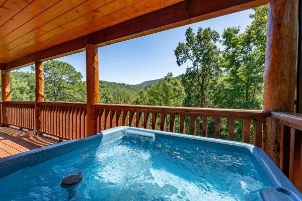 Looking out onto the hillside at The Great Outdoors, a 3 bedroom cabin rental located in Pigeon Forge