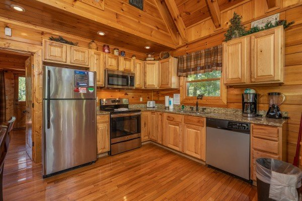 Kitchen with stainless steel appliances at The Great Outdoors, a 3 bedroom cabin rental located in Pigeon Forge