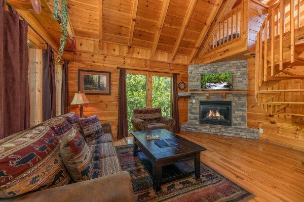 Fireplace in the living room at The Great Outdoors, a 3 bedroom cabin rental located in Pigeon Forge
