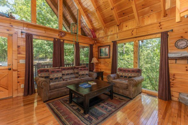 Sofa and chair in the living room at The Great Outdoors, a 3 bedroom cabin rental located in Pigeon Forge