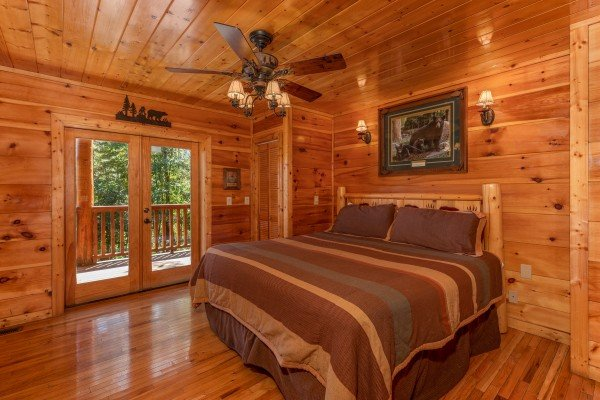Bedroom with deck access at The Great Outdoors, a 3 bedroom cabin rental located in Pigeon Forge