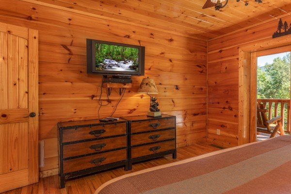 Dresser and TV in a bedroomat The Great Outdoors, a 3 bedroom cabin rental located in Pigeon Forge