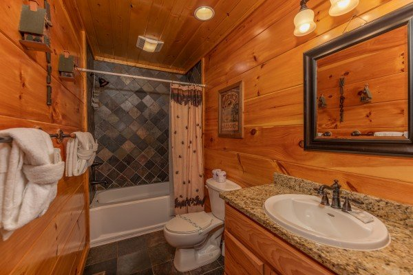 Bathroom with a tub and shower at The Great Outdoors, a 3 bedroom cabin rental located in Pigeon Forge