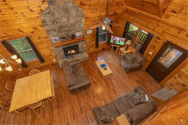 Looking down at the living room at Family Getaway, a 4 bedroom cabin rental located in Pigeon Forge
