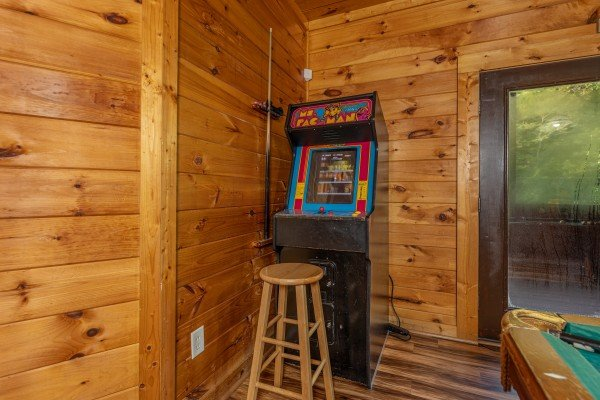 Arcade game at Family Getaway, a 4 bedroom cabin rental located in Pigeon Forge