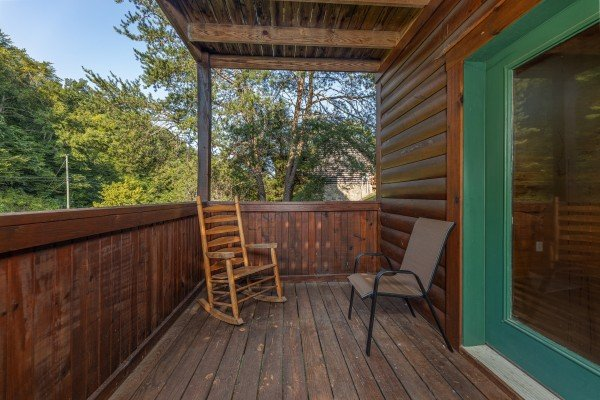 Deck seating at Family Getaway, a 4 bedroom cabin rental located in Pigeon Forge