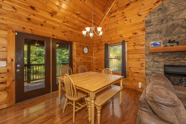 Dining room with seating for 6 at Family Getaway, a 4 bedroom cabin rental located in Pigeon Forge