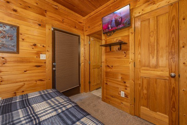 TV in a bedroom at Family Getaway, a 4 bedroom cabin rental located in Pigeon Forge