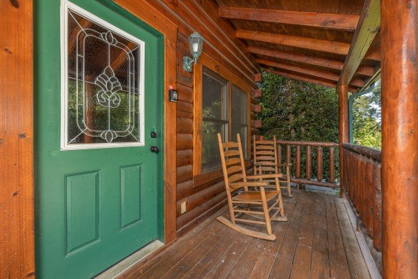 Front door on a covered deck at Family Getaway, a 4 bedroom cabin rental located in Pigeon Forge