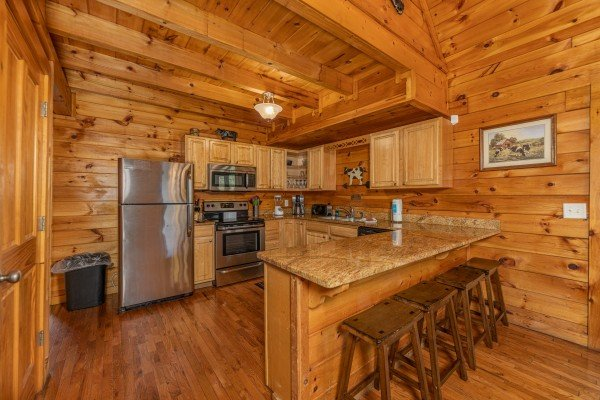 Kitchen with stainless appliances at Family Getaway, a 4 bedroom cabin rental located in Pigeon Forge