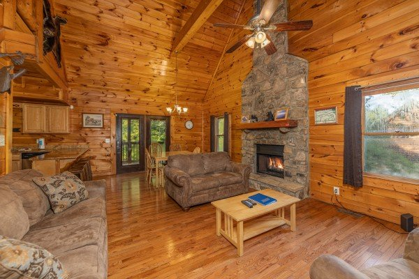 Seating and fireplace in a living room at Family Getaway, a 4 bedroom cabin rental located in Pigeon Forge