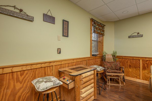 Arcade game at Southern Charm, a 2 bedroom cabin rental located in Pigeon Forge