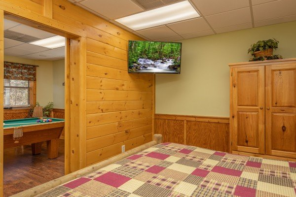 TV and armoire in the game room at Southern Charm, a 2 bedroom cabin rental located in Pigeon Forge