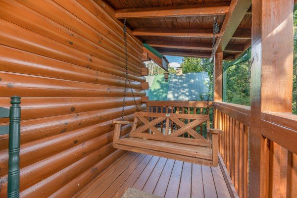 Swing on a porch at Southern Charm, a 2 bedroom cabin rental located in Pigeon Forge