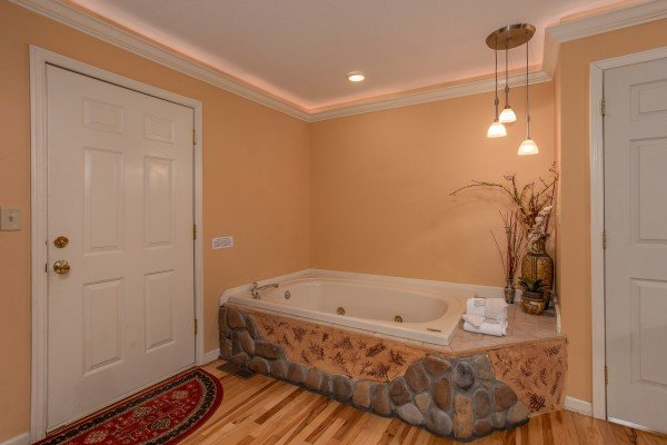 Jacuzzi and deck access in the bedroom at Eastern Retreat, a 1-bedroom cabin rental located in Gatlinburg