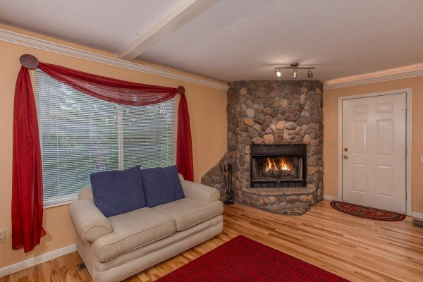 Sitting area next to the fireplace in the bedroom at Eastern Retreat, a 1-bedroom cabin rental located in Gatlinburg