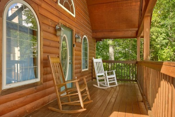 Covered front porch with rocking chairs at Eastern Retreat, a 1-bedroom cabin rental located in Gatlinburg