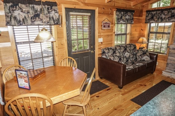 Dining area doubles as a game table at Seclusion, a 1 bedroom cabin rental located in Gatlinburg
