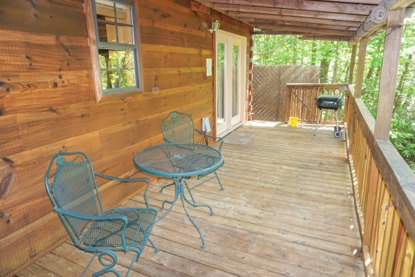 Charcoal grill on the deck at Seclusion, a 1 bedroom cabin rental located in Gatlinburg