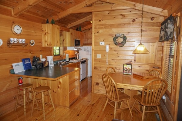 kitchen and dining area at seclusion a 1 bedroom cabin rental located in gatlinburg
