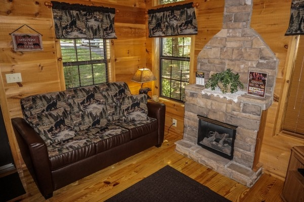Sofa bed in the living room at Seclusion, a 1 bedroom cabin rental located in Gatlinburg