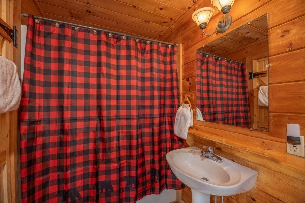 Bathroom with a tub and shower at Away From it All, a 1 bedroom cabin rental located in Pigeon Forge